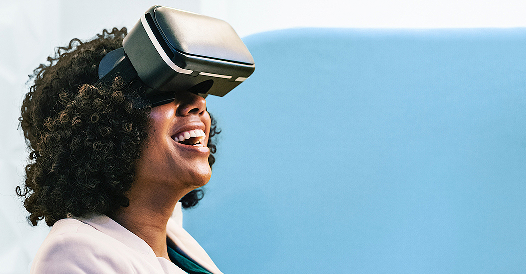 Image of a woman looking up with VR glasses