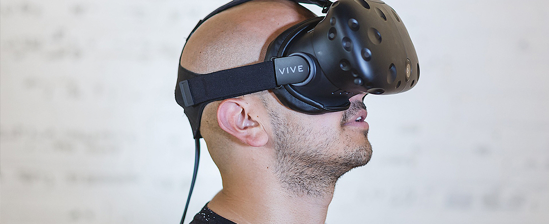 Man with vr headset looking up into air